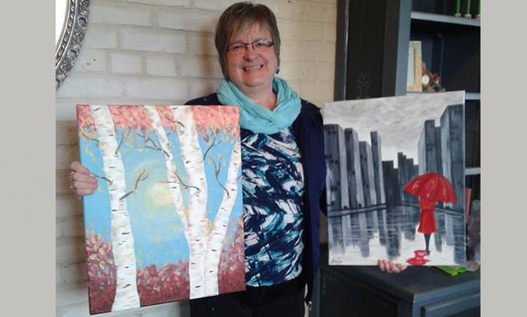 Heather showing sample paintings