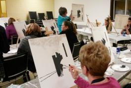 Instructing a painting class